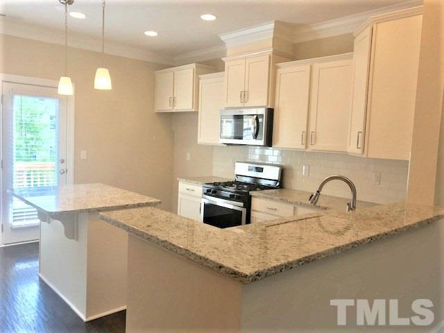 Come see our Beautiful three story townhomes with guest suite down … very open floorplan with lots of Upscale features!  Great Apex location!  come before they're gone.. this is our last townhome building!