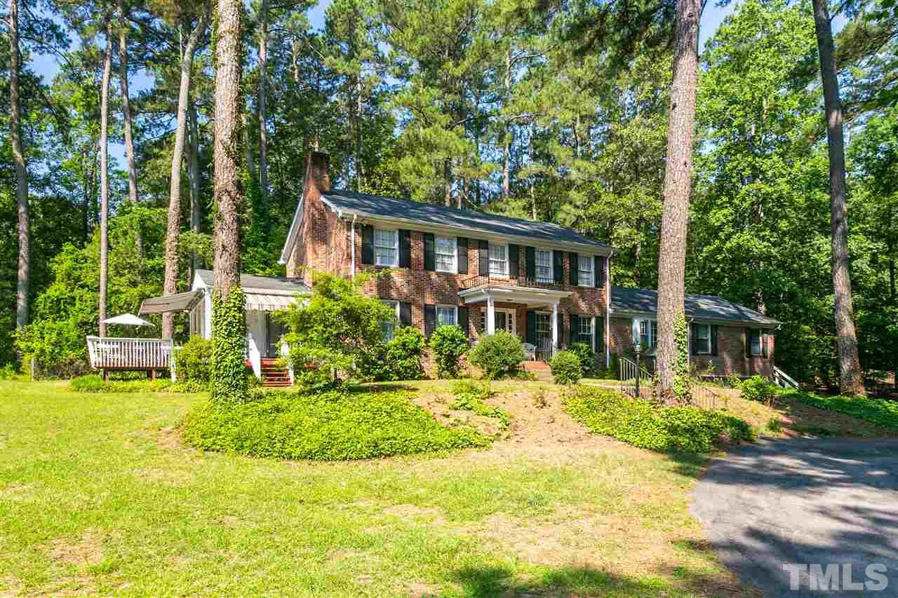Are you tired of HOA's & want some land around you? This stately brick home is situated on 3.52 acres & is tucked away behind trees. Drive down the circular driveway & you will see a lovely stocked pond w/ gazebo & dock. This home has hardwoods upstairs & down. If you don't need your master on the main level you can use the master as an in-law suite. Or just use the office as the suite. It has a private entrance w/ kitchenette & bath rm. Newer HVAC. Horses allowed. Minutes to 540 - county taxes.
