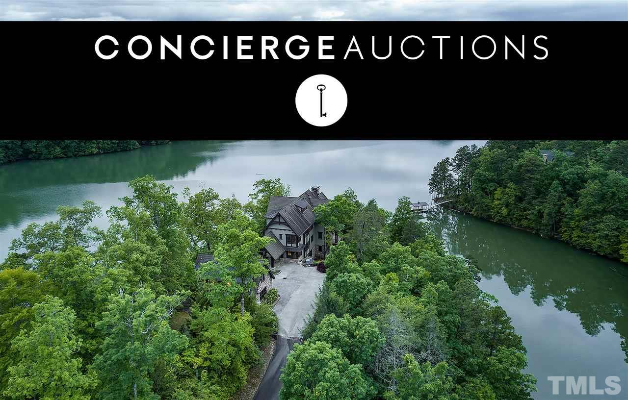 AUCTION: New Auction Price $7.85 Million. Without Reserve. Live Auction June 24th-27th. Open Daily by Appt. Come home to a luxurious lakefront sanctuary on your very own peninsula surrounded by majestic forest and peaceful waters. Your finely appointed estate at 410 Lakewood Drive blends modern amenities with rustic charm. Rich hardwoods and artisan details perfectly frame walls of glass that invite the spectacular vistas inside. You'll want to live outdoors in your choice of patios. Call for details.