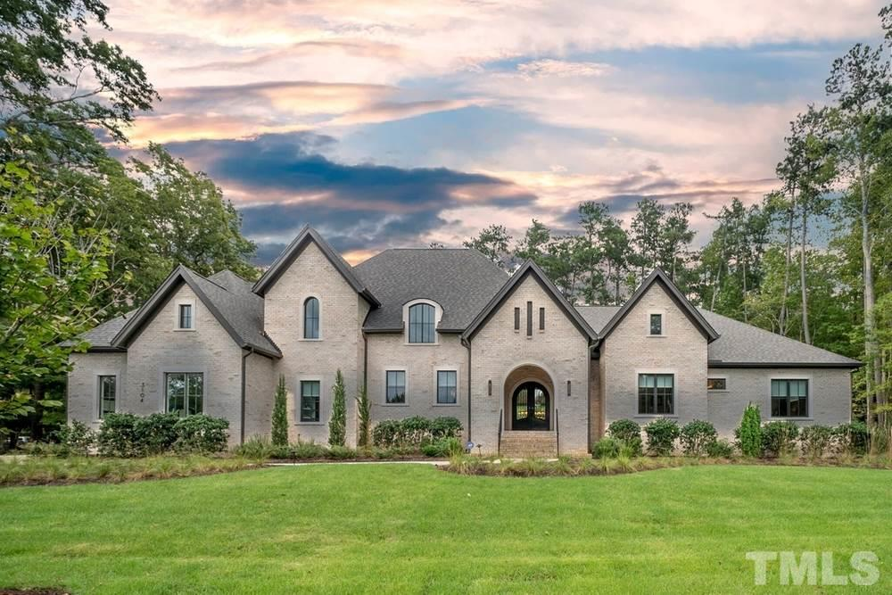 This unrivaled, ~6200SF, SINGLE floor transitional estate home offers comfort w/ modern elegance & openness, 3 miles from Duke on 1.23 acres!  Meticulously designed w/ no feature or upgrade overlooked. Black walnut hardwoods throughout.  Top-of-the-line chef's kitchen w/ professional grade appliances & 11x6 island.  Indoor/outdoor living area overlooks Zen garden & reflection pond. Entertain in style w/ pub, gaming area, theater, gym & b-ball court.  2 luxurious master suites! Protected wooded views!