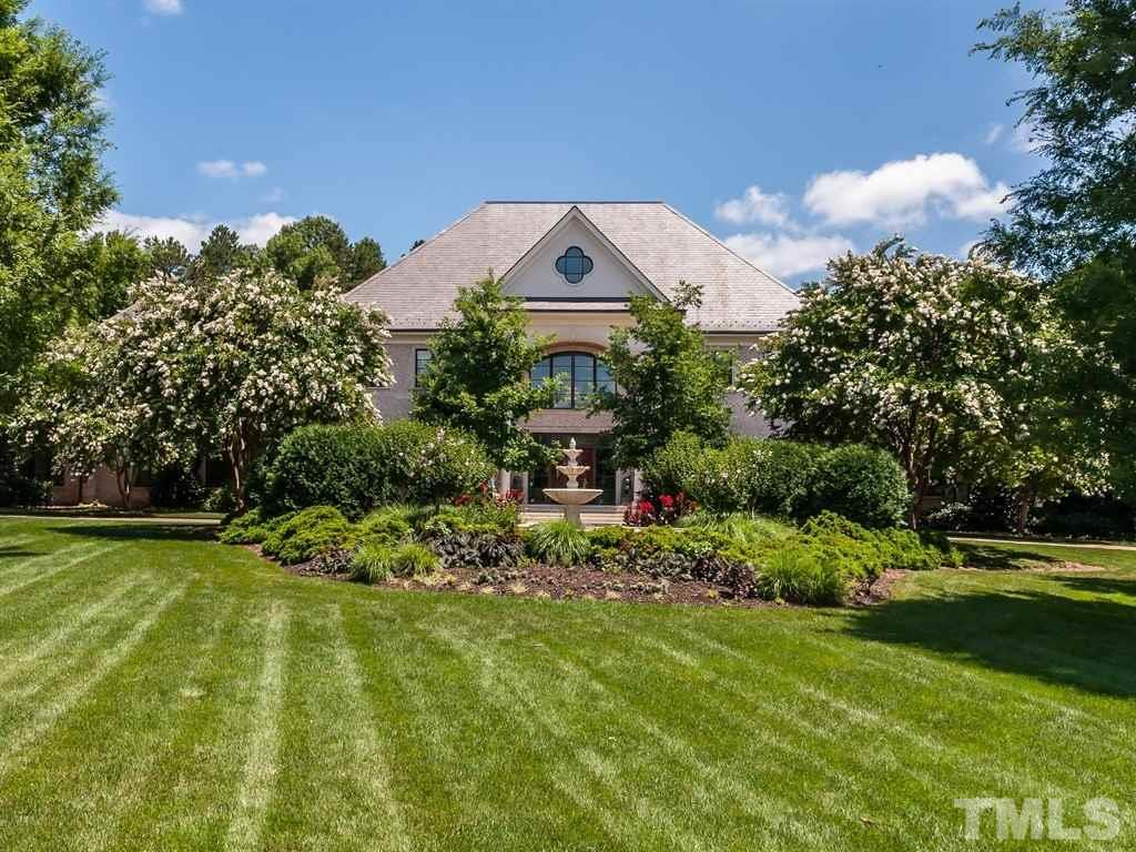 One of Raleigh's finest! Nestled on a private 3.86 acre lot, the architectural integrity and construction of this magnificent brick two-story w/slate roof is without equal - the property features an open plan with generously proportioned spaces utilizing the finest materials and craftsmanship - this extraordinary home  is further enhanced by the magnificent two-story foyer w/Koi pond, state-of-the-art kitchen, resort-like MBR suite, spacious in-law suite, gorgeous pool and a  6-car garage - indescribable!