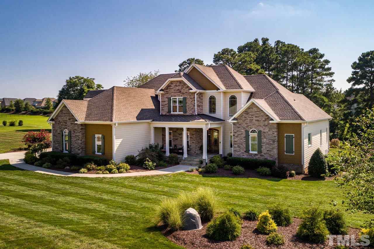 You must experience this stunning, like-new custom home on 1.7 acres w/pond access, over-sized 5 CAR garage, & resort custom POOL.  2 BR's on main fl. Open concept Great Room w/Gorgeous white gourmet kitchen. Large Master Retreat + Spa Bath.  Sealed Crawl, whole house Generac generator, This home is loaded!  See special features/brochure. No HOA, Septic & Well.  Located near downtown HS, Bass Lake, Golf Courses, 540 Access, shopping & parks & trails.