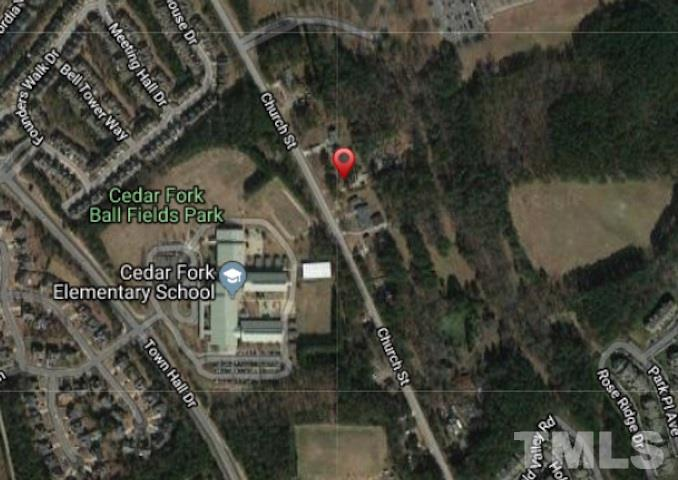 INVESTMENT LAND in highly sought after Morrisville! 2.5 acres consisting of 3 adjacent lots sold as package.  107 ft of street frontage and lots back up to 30+ acres of wooded land.  Lots include house, building/shop, and wooded land.  Close to schools and high density residential. Minutes from RTP, I-40, I-540, and RDU .    Seller not removing existing buildings. Showings available to walk the lots but do not include access to house. Survey in Documents