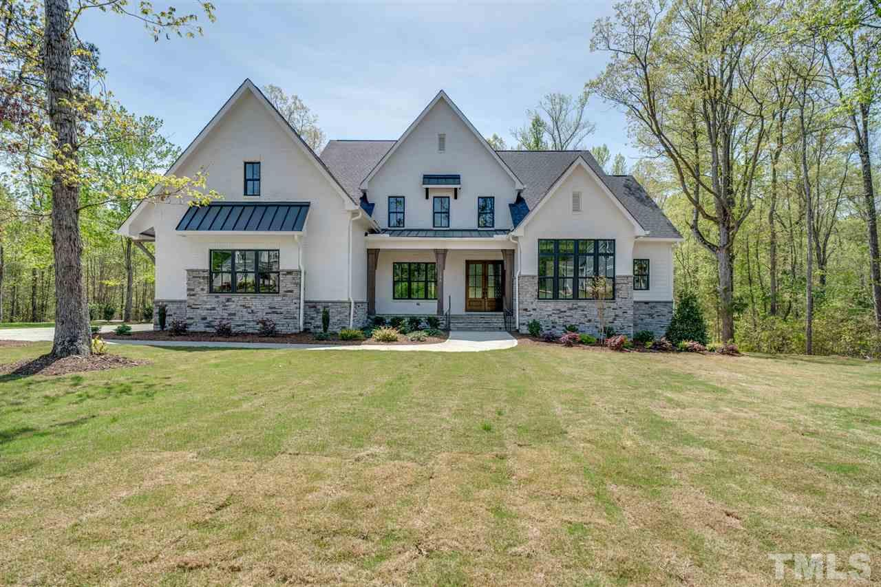 Modern Farmhouse on almost 4 acres of pure privacy in upscale Lexington. Custom home with high end features and high end quality! Two story home with huge first floor living.  Complete with Arthur Rutenberg's famous oversized laundry room with island, 2nd fridge space, arrival center.  Walk-in Pantry room you have to see to believe. Outdoor Living, Club Rm; Media Rm.  Every Room is better than the next!  All selections have been chosen by a professional designer or choose your own for a limited time.