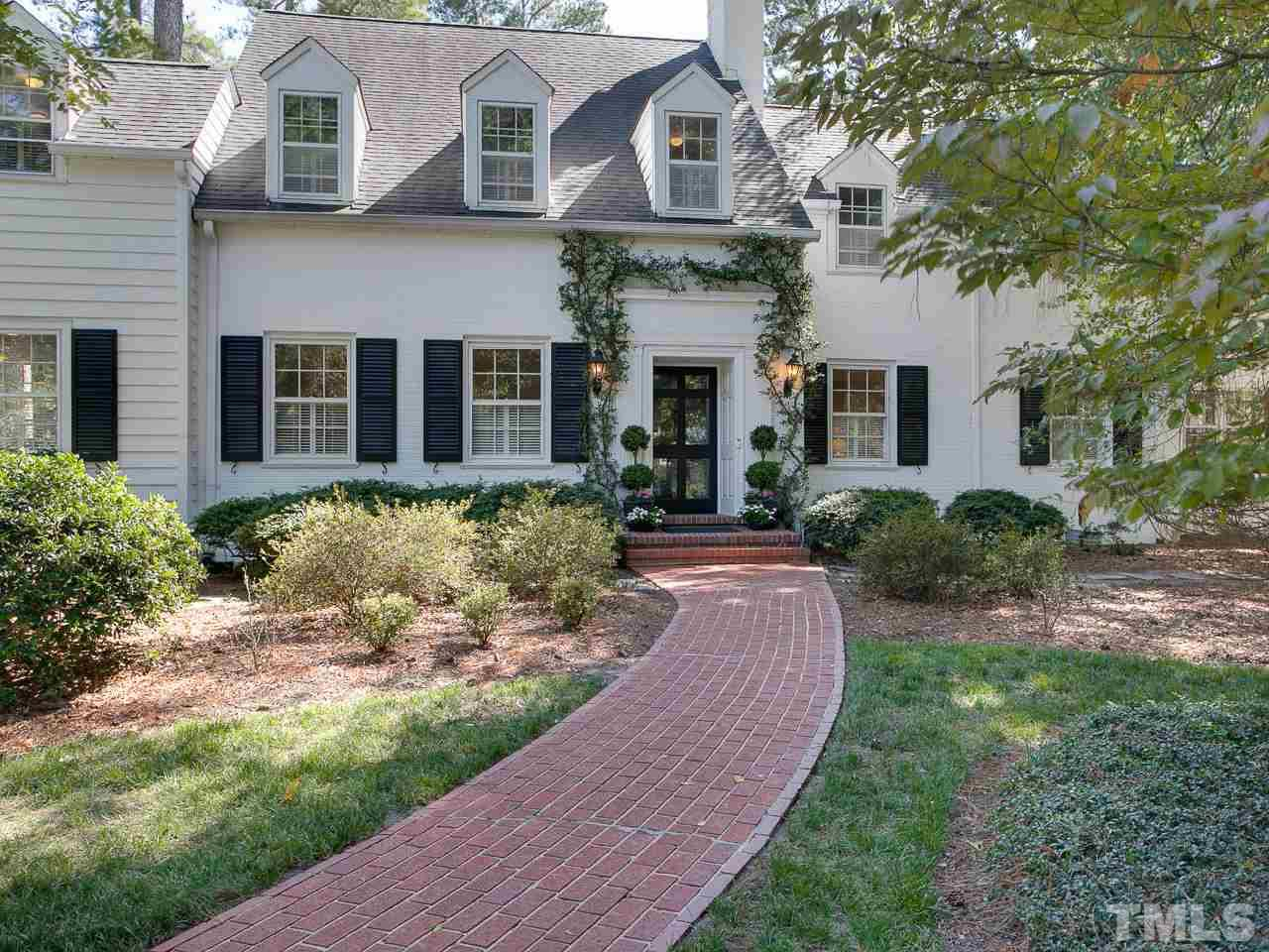 A rare opportunity to own a meticulously preserved George Watts Carr Colonial Revival elegant beauty.  This historical treasure has been methodically updated to preserve its original character & offers a high-end Subzero gourmet kitchen featuring Carrara marble, a luxurious stylish master bath, two quintessential fireplaces & handsome hardwoods throughout. A private covered intimate back porch, deck & patio offer unparalleled views of the Hope Valley golf course & is perfectly perched on the 7th green.