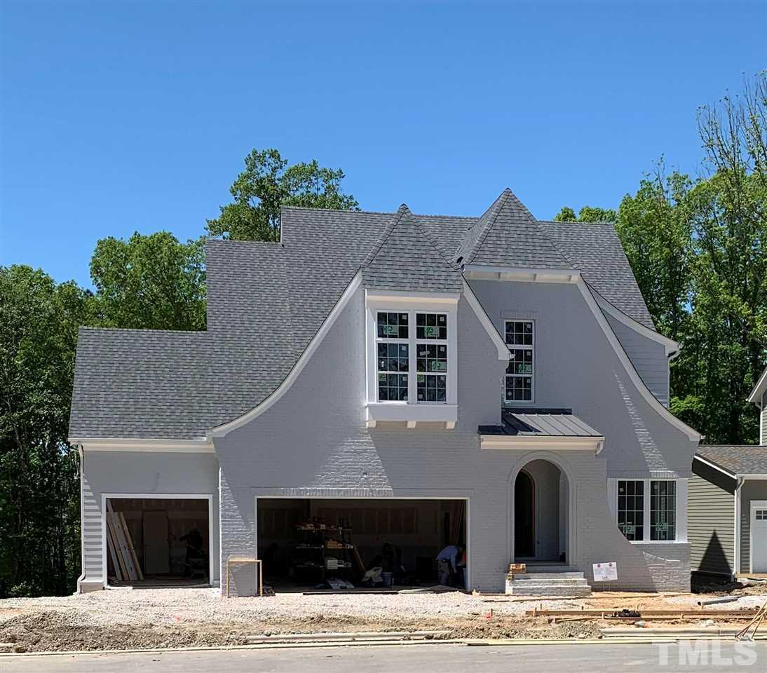 Exceptional Loyd Builders Custom Residence in Sweetwater in Apex. Home features 4 bed/4.5 baths, 3-car gar. Unfin attic, 2nd floor Game/Bonus Rm. Full unfinished w/o BASEMENT. Home backs to mature trees/open area. 2 FP's, covered screened porch w/FP and deck, perfect for entertaining or quiet time at! Bright open kitchen that flows into the over-sized FR with yet another FP! This home has it ALL! AND....Loyd Builders elegant design and touch in this elegant custom residence in Sweetwater.