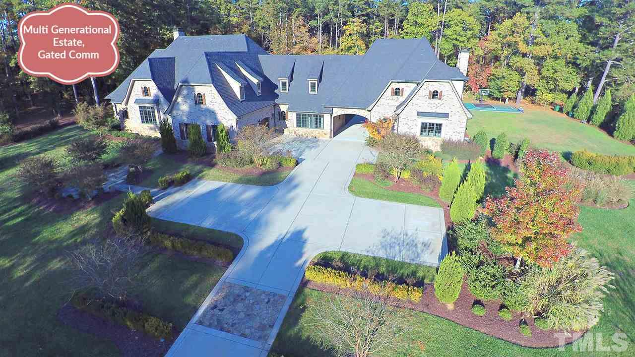 "Like New Rufty Custom Built for Multigen living, w/every detail carefully planned by owner. Gated NRal Comm. 2 homes separate yet connected via porte cochere & elevator, w/meticulous attn to detail-Chef Kit, SS Sub Zero & Wolf App, Site Built 4-6"" Oak Fl, Calcutta Marble Counter, Custom Inset Soft Close Cabinets, Top of Line Fixt, Massive Pantry/Prep Area, Vaulted Ceiling w/exp wood beams, 2 Laundry Rms, 4car Gar w/5th Bay used as Heated Wkshop, 2 Screened Porches w/Blt-In Grills, MBR Stm Shwr,Det Flex Rm"