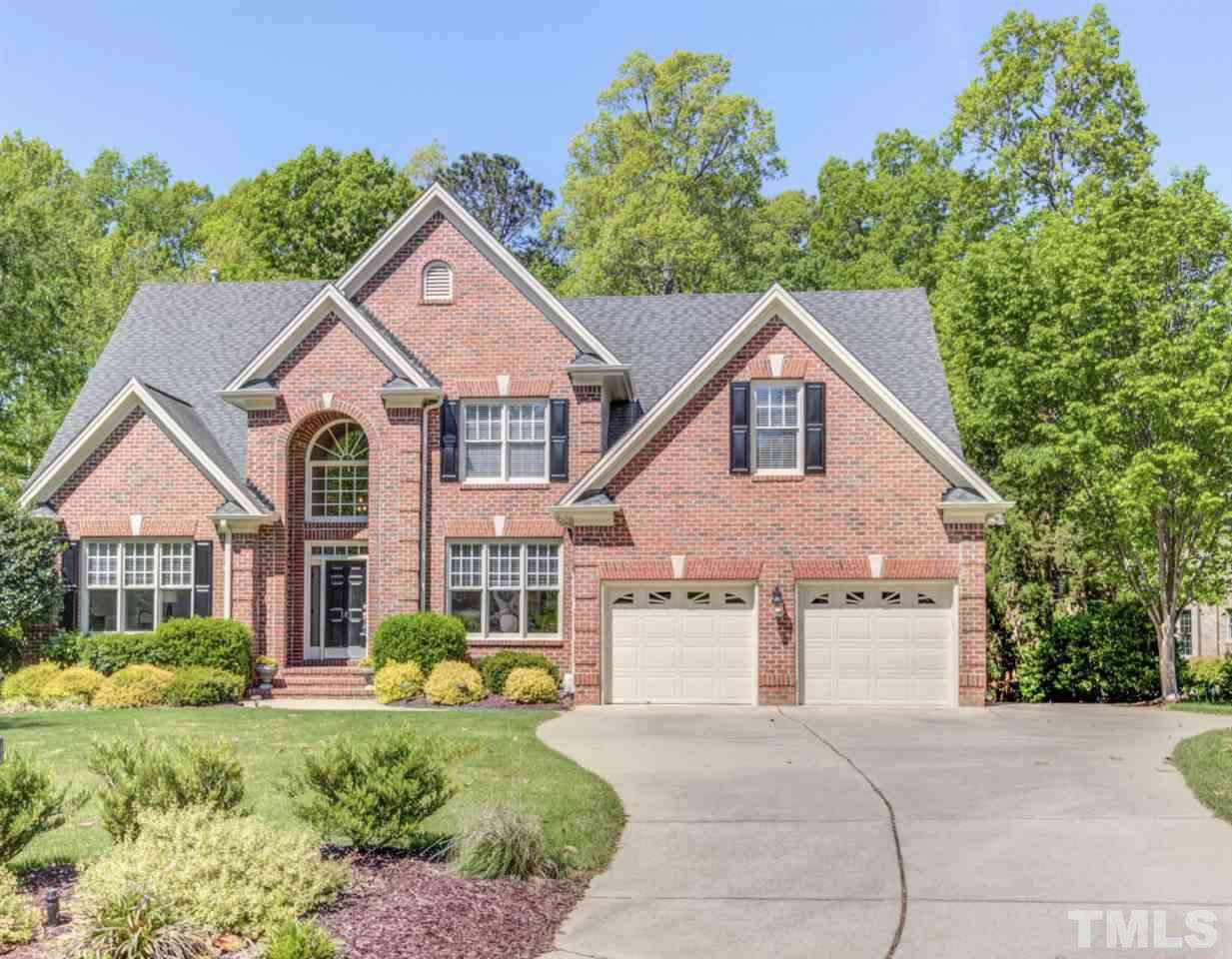 Stunning all brick executive home w/flowing floor plan. Newly painted interior w/over 4600 sq ft of luxury. Brightly lit spacious rooms, HDWDS & SEP formals. Chef's KIT w/Dacor built-in oven/microwave, 5 burner gas cooktop & island; opens to FAM RM w/stone surround FRPLC & breakfast RM. Main floor owner's suite w/WIC. Bonus, 3 BD/2BA & FIN STG on 2nd floor. Private back lawn, deck & patio overlooks mature trees. Walk-out BSMT w/golf cart garage. Convenient commute to shopping, grocery, RTP & more!