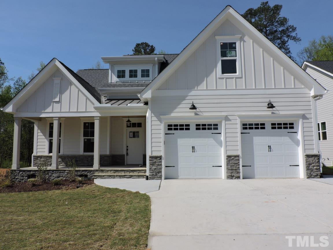 """1ST FLOOR MASTER & GUEST SUITE! 5"""" HWDs Thru Main Living! GourmetKit: Granite Ctops, Cstm Cabs, CenterIsland w/Brkfst Bar & Pndnts, SS Appls, & Large Walk in Pantry! Open to Dining w/FrenchDoor to Scrnd Porch! Master: w/Foyer Entry, Plush Carpet, Ceiling Fan! MBath: Tile Floor, Dual Vanity w/CulturedMarble, Garden Tub w/Tile Srrnd & Privacy Window, Walk in Shower w/BenchSeat, & Walk in Closet w/Cstm Shelving! FamRm: HWDs, Cstm Stone to Ceiling Srrnd GasLog FP w/Mantle & Blt Ins! Upstairs Bonus & Loft!"""