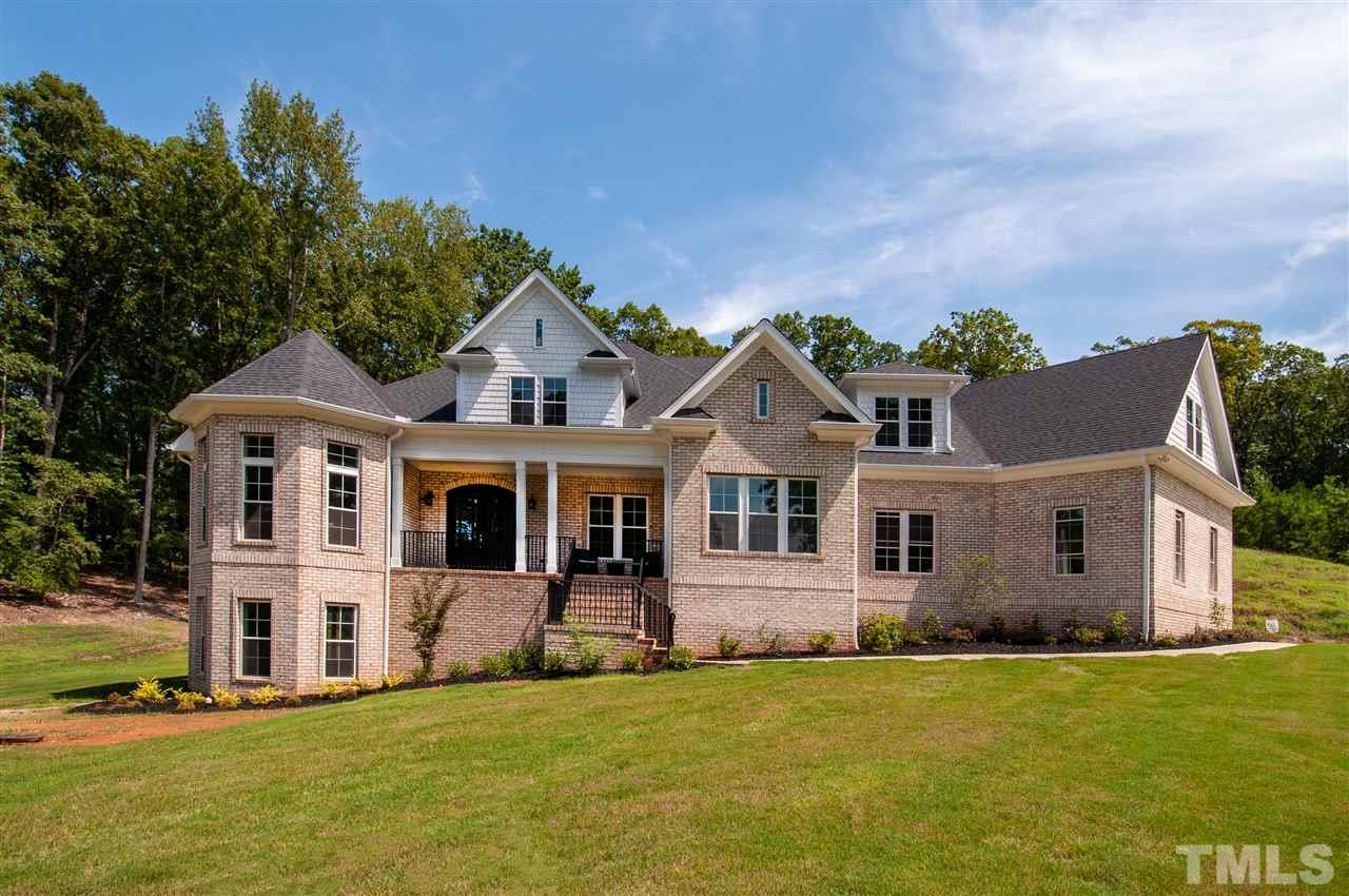 "Stunning custom built home on 1.30-acres. Lovely hdwds, tile flrs &granite counters thru out; soaring, coffered & trey ceilings. SS appl's incl 48"" 6-burner gas stove w/griddle, pot filler & island. 3 stone gas log FP's, custom built-ins. 1st flr MB has bath w/free standing whirlpool & steam shower. Sun room, bonus w/wet bar, 3rd flr flex rm w/bath & closet. Full bsmt w/kitchenette, rec area, media rm, full bath, flex rm & WI-storage. 2 safe rooms. Conv to Falls Lake. Priced well below appraised value."