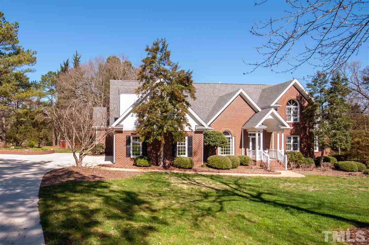 All brick home lives like a ranch. Gardener's heaven w/17 yrs of composted soil & private irrigation well. Split BR plan offers lrg LR w/gas log frpl & built-in entertainment ctr. Cook friendly kit w/granite counters, SS pro series appl's, eat-in bar area, brkft area w/built-in desk. Adjoining sunroom w/cathedral ceiling & wall of windows for tons of natural light. Huge bonus on 2nd flr w/built-in shelves. WI-attic framed for 4th BR & full bath. Room for pool. Conv to Aquatic Center & Neuse River Trail