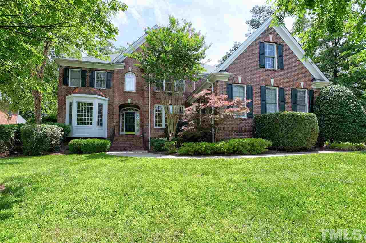 AMAZING custom all brick home. Every creature comfort so you never have to leave! 5 large beds (1st fl. guest bed) HOME THEATRE, hot tub, study, office & exercise rm. Dual fp in master bed rm/bath! Lge sunroom overlooks very PRIVATE FENCED YARD w/ BEAUTIFUL plantings, flagstone walkways, pergola & firepit. EXOTIC GRANITE just installed in all bths NEW ROOF! 3 car garage. Prestigious community w/walking trails, comm. pool and UNBEATABLE LOCATION very convenient to airport, RTP & all parts of the Triangle.