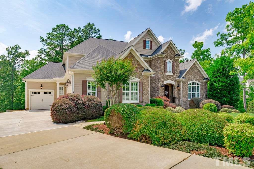 Absolutely BREATHTAKING custom home in 12 Oaks! Gorgeous golf course view w/full walk-out basement & 1st flr master! This STUNNER features 2 story foyer & massive greatrm w/fireplace & built-ins opening to a Chef's kit w/large island, prof SS appls, large pantry & ample storage. Mudroom & large laundry rm. Bedrooms w/full bath access. Walk in storage on 2nd flr. Basement w/wet bar, rec rm, bedroom, office & spectacular theatre room. Lower covered paver patio & screened in porch. Too many features to list!