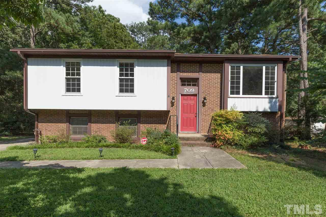 In the heart of West Raleigh you'll find this 1970 gem in one of the most sought after neighborhoods.