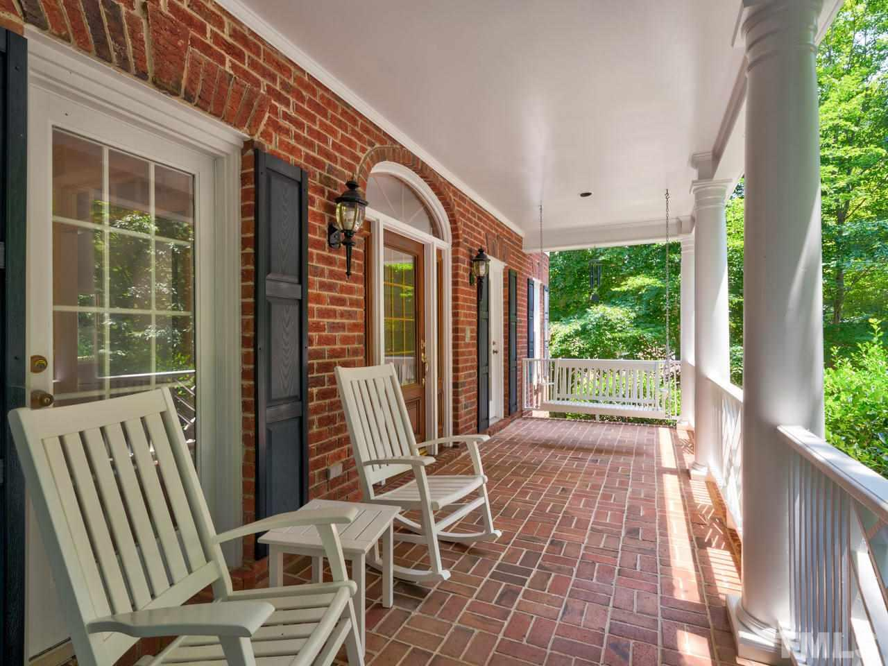 Come sit and relax on this delightful front porch!