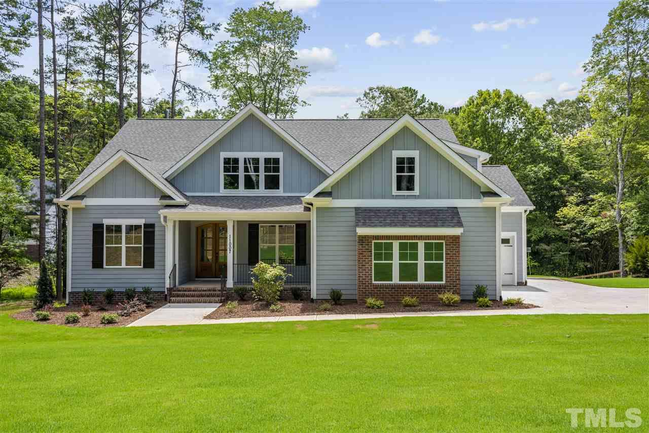 Welcome home to this new, custom constructed home on over an acre home site with no HOA/Covenants.  Relax on the front porch and enjoy your peaceful surroundings.