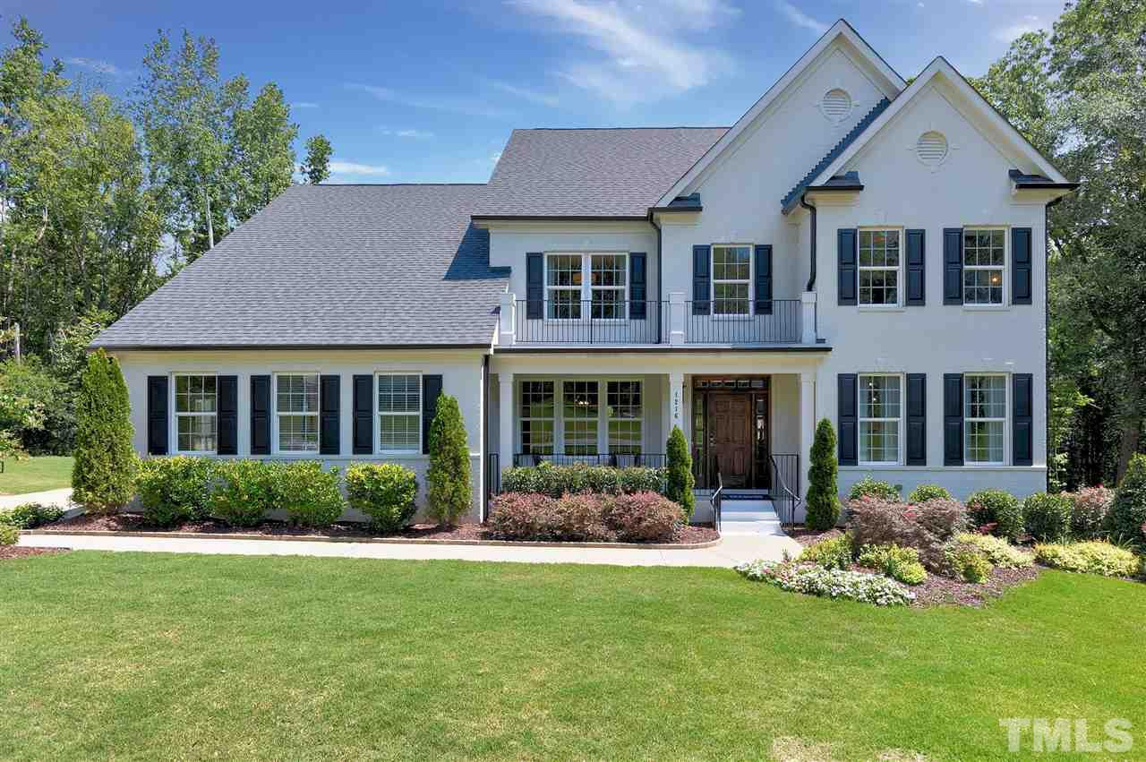 Beautiful Brick Front with side load garage.