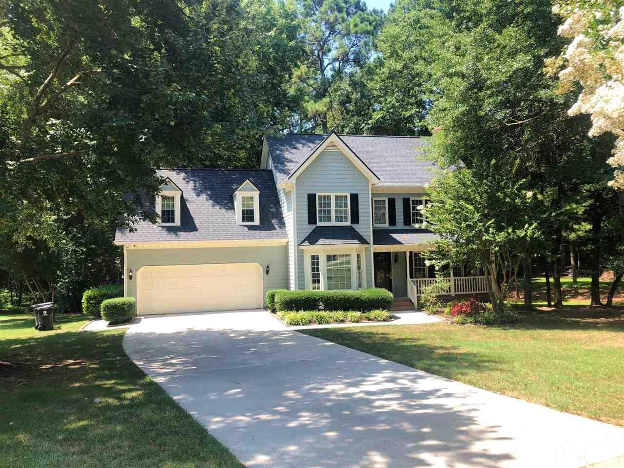 Welcome home to 1501 Ransom Ct.  A long level driveway wrapped in a well cared for lawn.