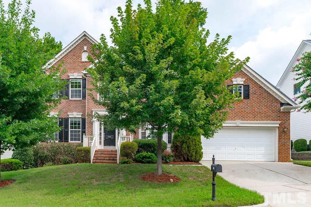Immaculately Maintained Brick Front Home