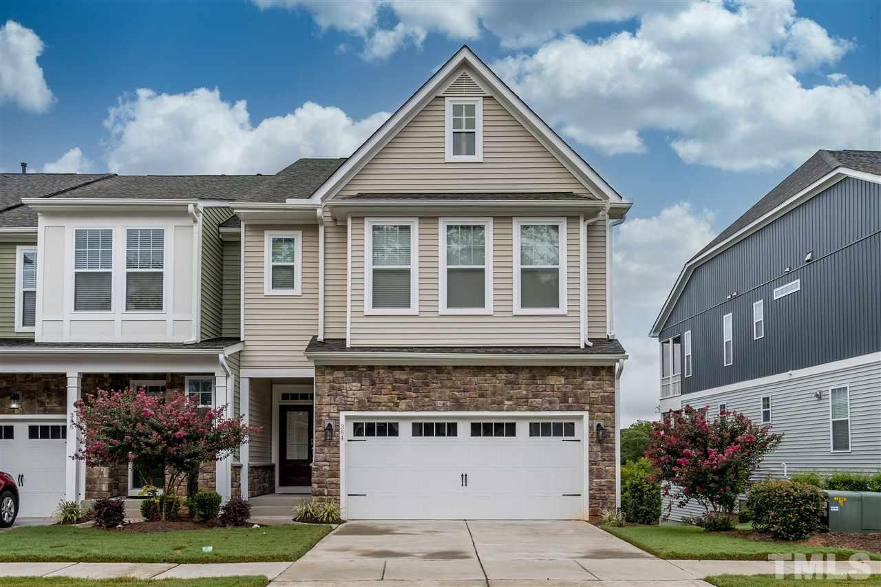 Stone accents and covered front porch. 2 car garage. Central Cary location.