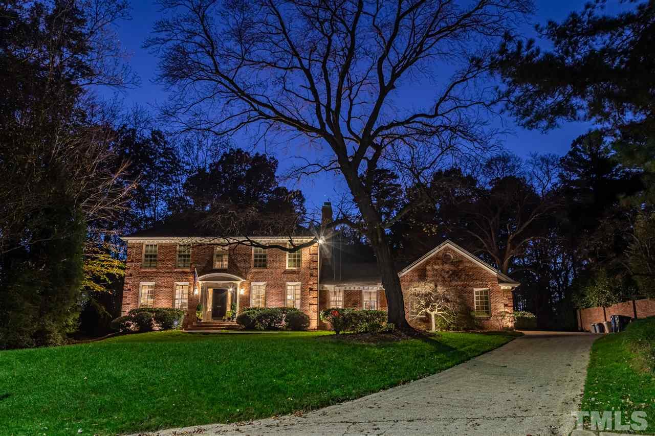 Front view of this elegant traditional, 2-story brick home.