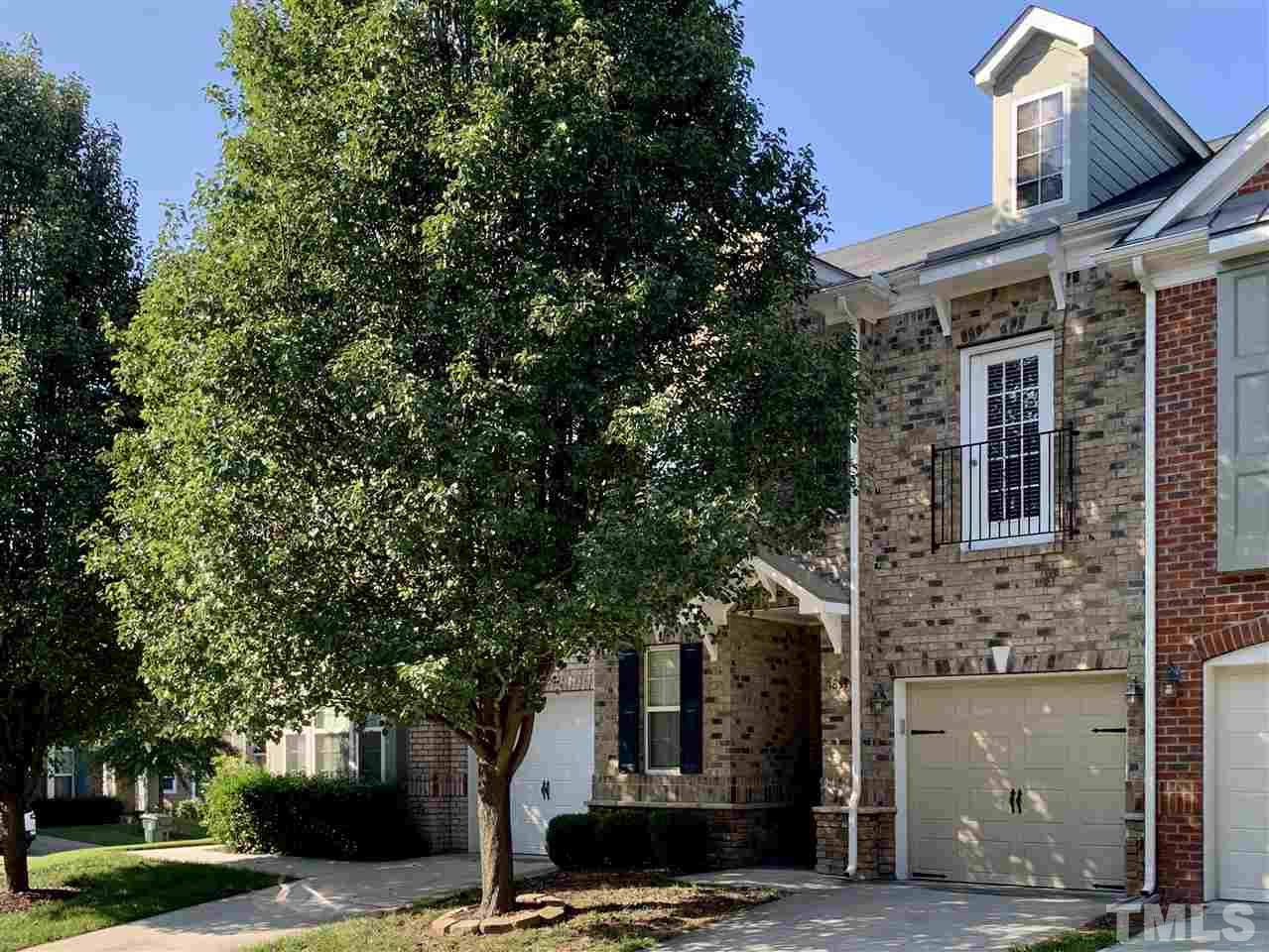 Stunning all brick townhome in the desirable Amberly subdivision in Cary with oversized covered porch overlooking plush common space.