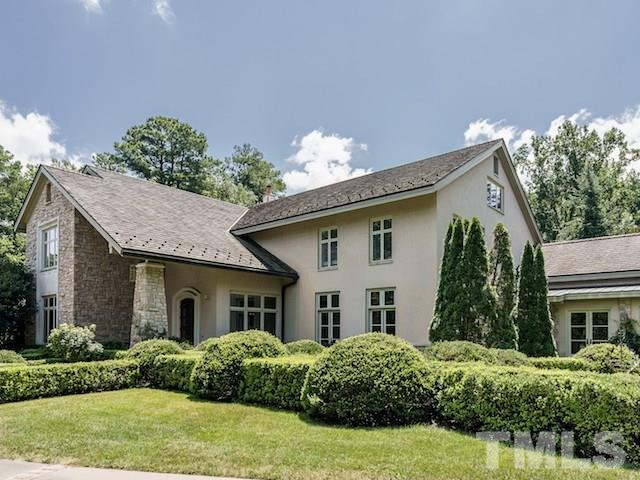 Picturesque inside and out, this stunning estate nestled in a lavish setting reflects the owner's talent in sophisticated attention to details and marvelous design. The elegant entry welcomes w/delight to soaring ceilings, oversized windows streaming w/natural light in a home featuring extensive use of impressive woods and stone along with chef's kitchen, marvelous master suite, exquisite formals, handsome library, 5 car garage, elevator and expansive areas for grand scale entertaining.