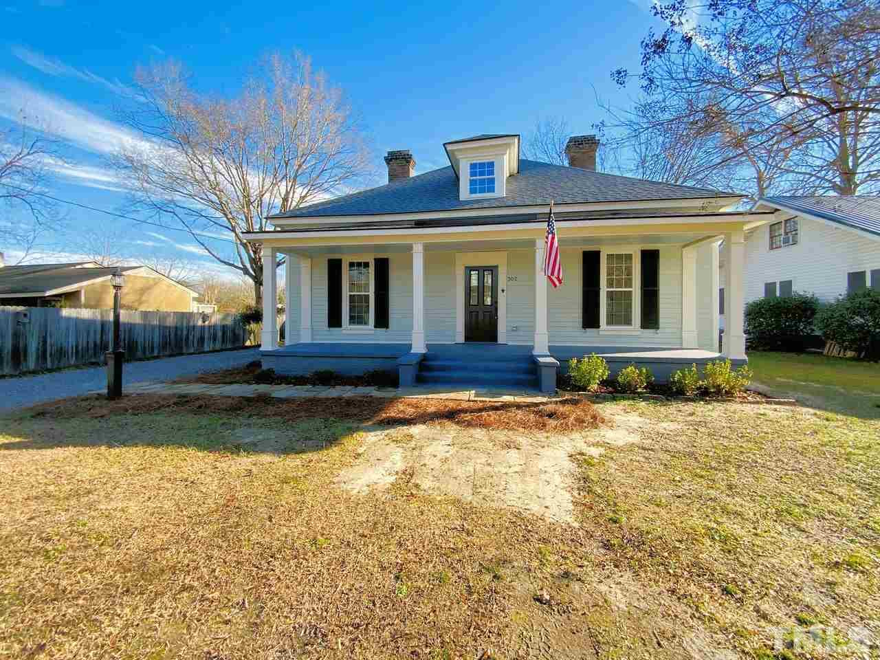 Beautiful renovation of 1917 home!  Extensive restoration and repair inside and out.  Home is a convenient walk to down town Zebulon.