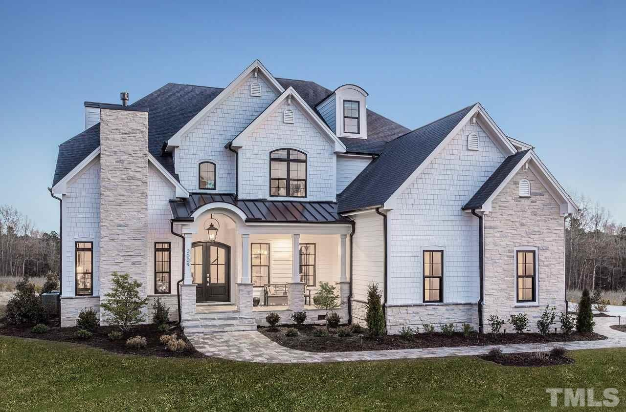 Custom model home. Too many upgrades to type. Remote screens on stone covered porch, dble islands, thermadore appls including commercial refig,2FPs,Wine room w/frig & glass walls, bdrm3 w/lft &ladder to it, shiplap ceilings &walls, dble stairs, side porch, ext gas lanterns, outdoor kit & grill, trex decking, balcony off mstr, zero entry shower w/6 heads, builtins, $80000 sound system,solid core doors t/o, irrig, low voltage liting, floating vanities, quartz t/o, flagstone walkways, dog house under strs