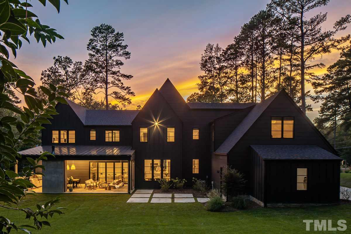 Amazing collaboration of Modern Farm House and Hamptons Style. Expansive open floorplan w/gourmet chefs kit, island w/seating for 5+, large dining rm, tons of natural light, covered outdoor kit w/grill & liv rm w/retractable screens and FP, office, gym, library, bonus. Main lvl guest suite. Upper level MBR w/custom WIC/dressing rm, spa-like retreat BA w/free standing soaking tub and walk-in shwr. XL BRs, playroom. Room for pool. Must see to appreciate the incredible blend of style and functionality!