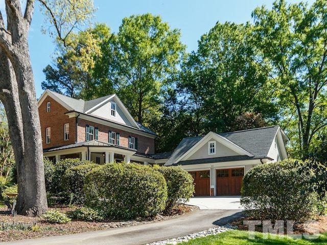 Hidden in plain sight, this magnificent home is where you & your family can have it all. Elem & Middle-schoolers walk to their top-notch schools as you head to work in your separate home office. Outdoor living is as important as indoor living here, from the genteel covered front porch to the private, 3-season brick & flagstone patio with fireplace & Phantom screens in back. No expense was spared: curved staircase, wood-clad windows, solid doors, 10' & 9' ceilings, rich hardwoods, luxury throughout! MORE!