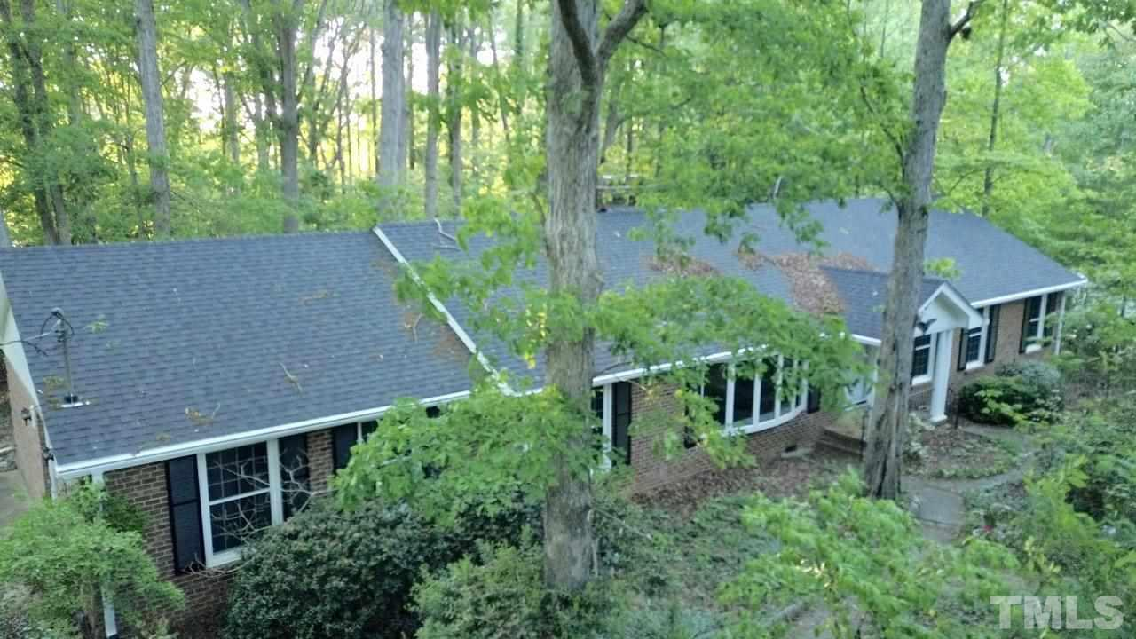 Nestled within a hardwood forest, this all brick ranch has been given a new lease on life, with upgraded kitchen, baths, new roof, (some) replacement windows, fresh paint.  HVAC is still young.  2 refrigerators, washer and dryer convey.