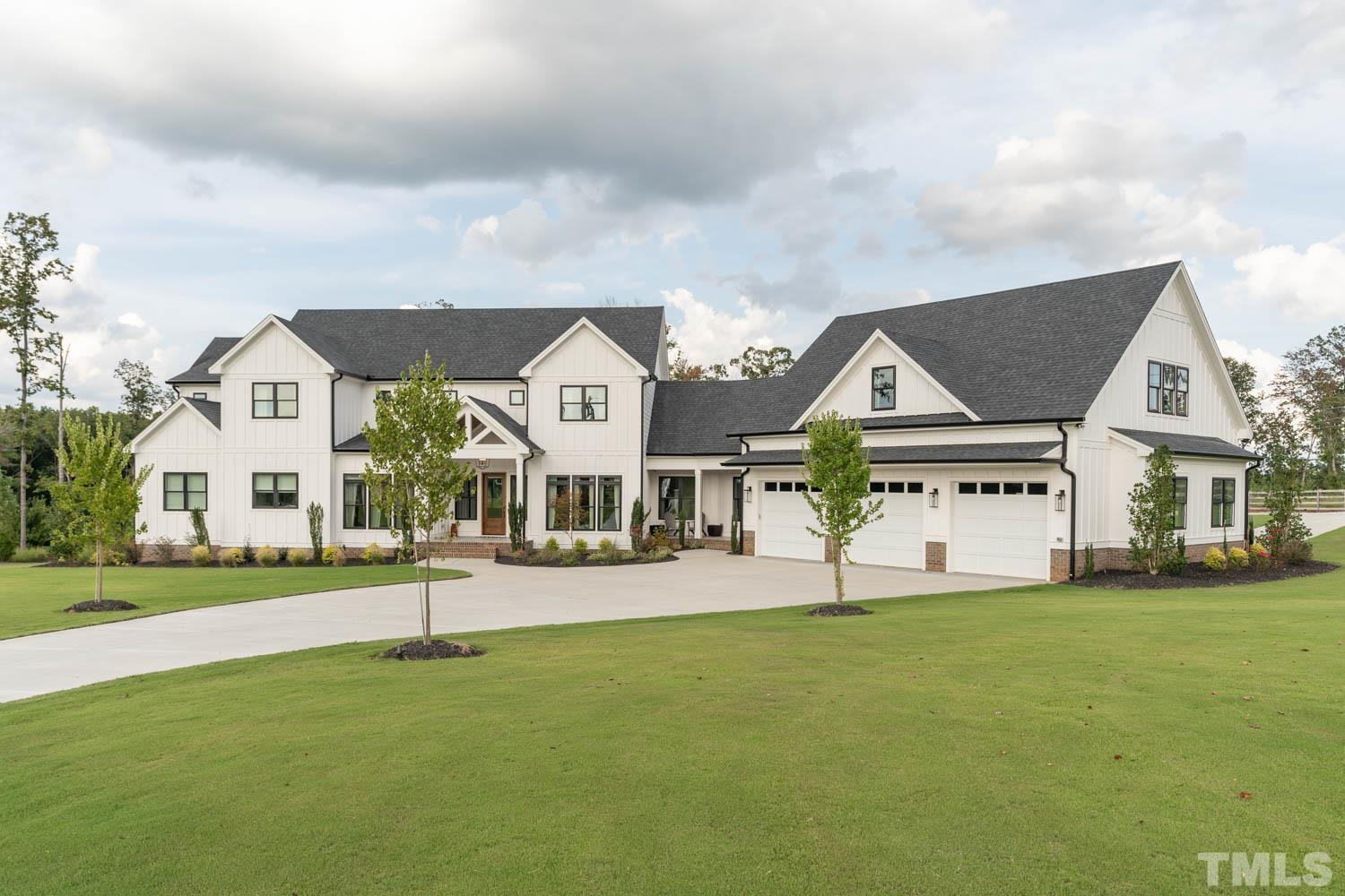 """TRULY ONE OF A KIND! GORGEOUS HIGH END CUSTOM """"MODERN FARMHOUSE"""" w/WOOD BURNING STOVE, CATHEDRAL CYPRESS CEIL & PORCHES, TILE PLANK FLRS 1ST FLR, PORCHES & GARAGE FLRS, THERMADOR KITCHEN SUITE 48""""FRIDGE/FREEZER,TWIN DISHWASHERS, 11' WIN-DOOR-OUTDOOR KITCHEN w/BUILT-IN GAS GRILLS PLUS, AUDIO THROUHTOUT, ENTERTAINERS DELIGHT, 1st FLR & 2nd FLR OWNERS SUITE, CONCRETE QUARTZ FINISH OZONE/UV SANITIZATION IN GROUND POOL, HOT TUB, WATERFALL, WALK-IN SAFE ROOM, 5 CAR TANDEM GARAGE, CONDITIONED 40X50 DETACHED SHOP"""