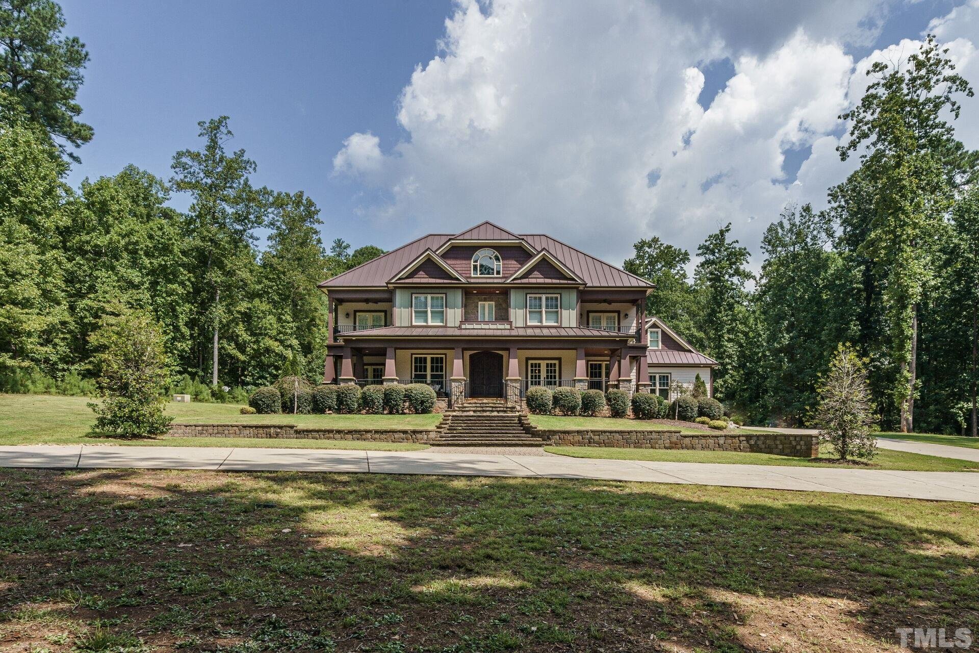 CUSTOM ESTATE HOME in Wake Forest on approx 5 acres. Every detail of this 5 bdrm/ 5+ bath home is custom. Reclaimed wood floor throughout. Sonos sound system inside/out, intercom & security system w/ cameras. Gas fireplace inside/wood fireplace outside. Gourmet kitchen w/ hibachi grill, custom cabinets & granite counters, 3rd floor gym w/ rubber matted flooring, spa master bath w/ heated floors & body spray, attached inlaw apartment w/ separate outside entrance. Conditioned playhouse. Movie Room and more!