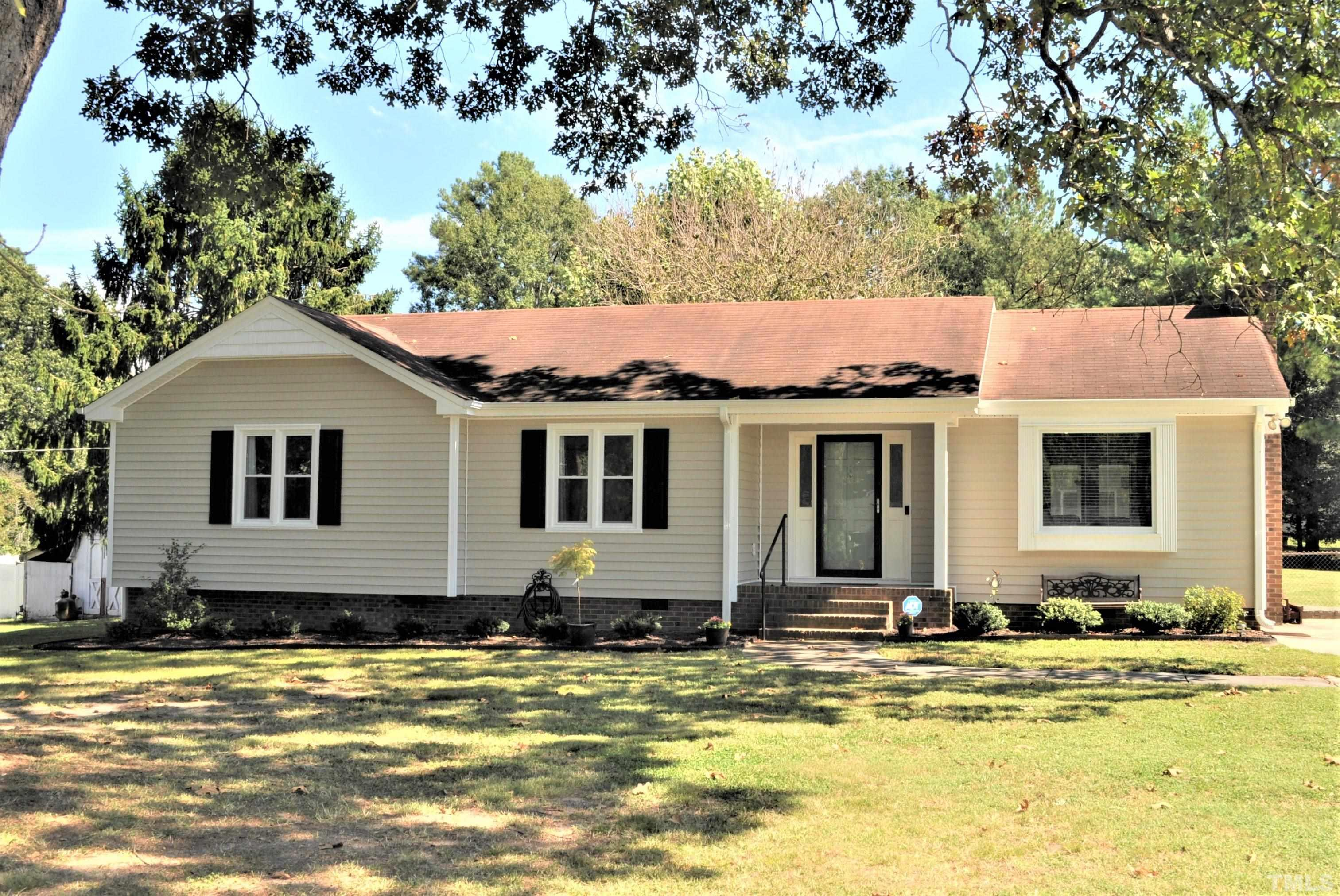 Neat as a pin and move in ready!!! Beautiful three bedroom, two bath home features many upgrades including granite counter tops, lots of fresh paint and new flooring, plus a screened porch, fenced yard and two storage buildings (16 x 24 and 11 X 15). Situated on a nice .72 acre lot, just outside the city limits with city water connected & no HOA fees. Refrigerator, washer & dryer included... conveniently located just minutes from I-40 and 540. Don't miss this one, make an appointment today!