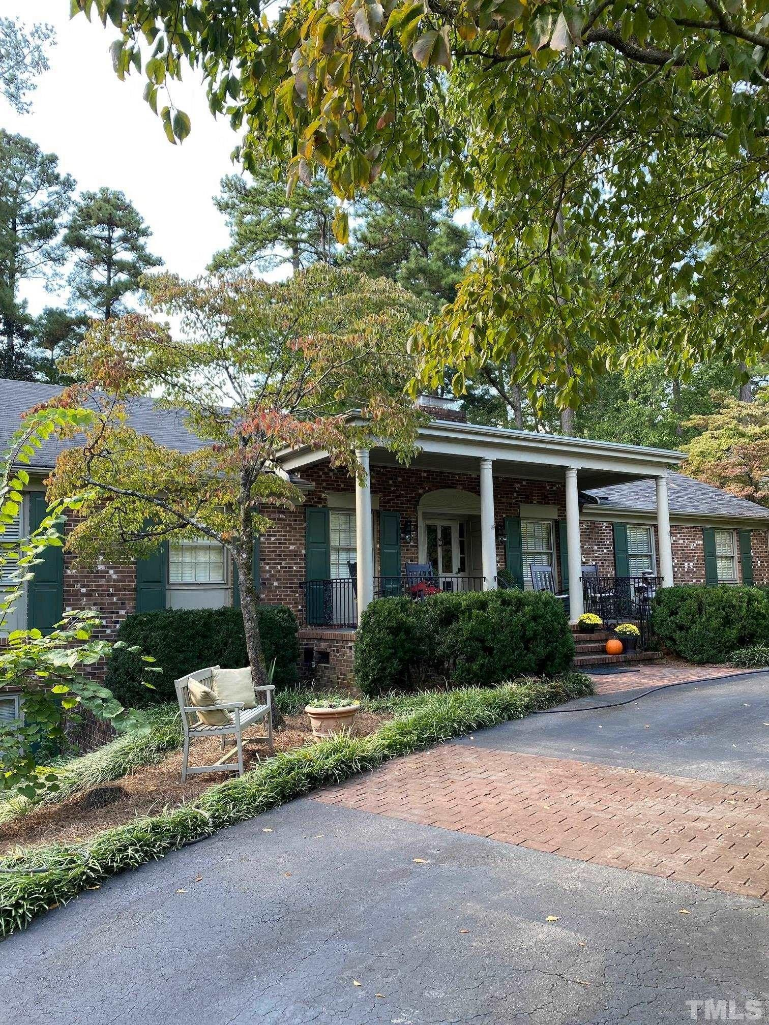 Beautiful brick ranch with rocking chair front porch